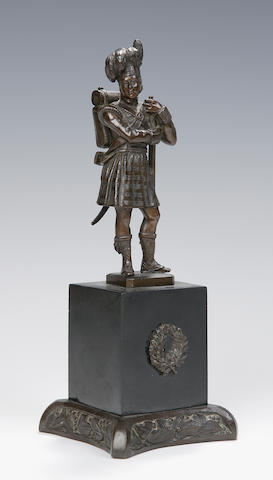 A late 19th or early 20th century bronze figure of a kilted soldier