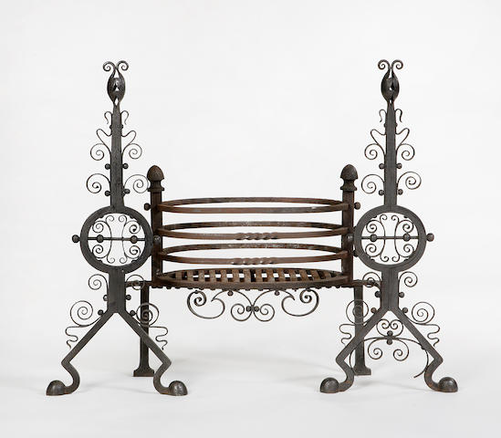 A late 19th century wrought iron fire insert