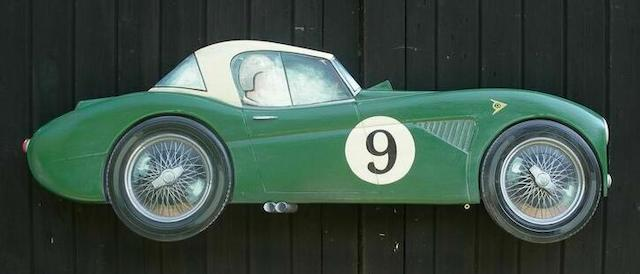 A Hand painted wooden profile of a competition Austin Healey 3000,