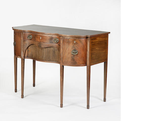 A George III mahogany and inlaid serpentine sideboard
