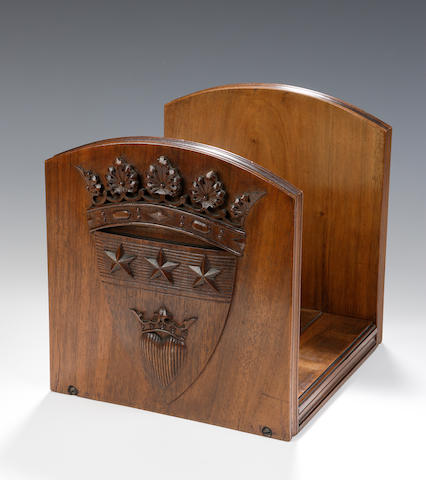 A late 19th/ early 20th century carved walnut book slide