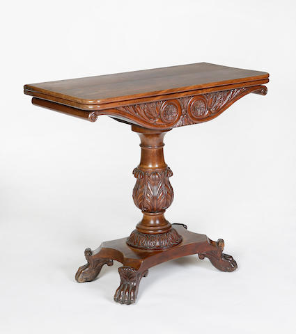 A Willliam  IV mahogany foldover tea table