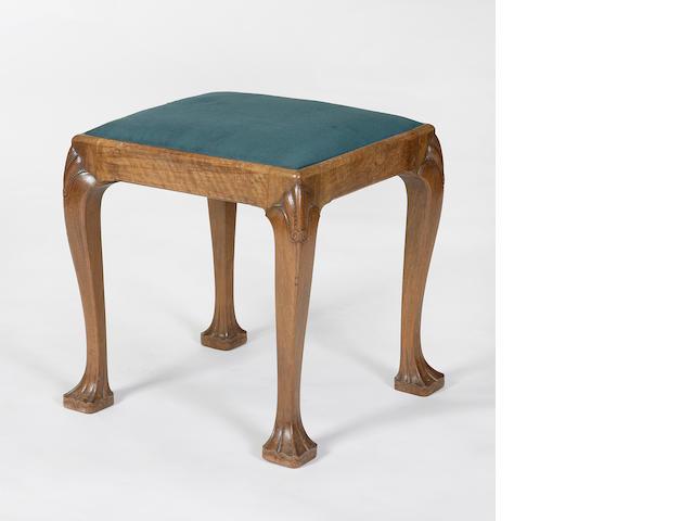 A Whytock & Reid carved walnut stool