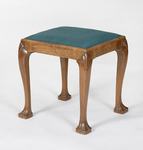 A Whytock & Reid carved walnut stool