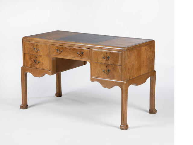 A Whytock and Reid walnut desk