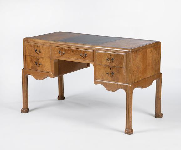A Whytock and Reid walnut desk