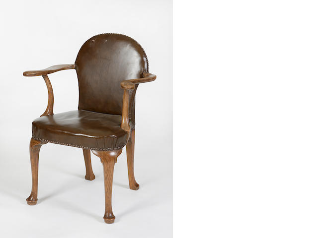 A Whytock and Reid oak and leather upholstered elbow chair