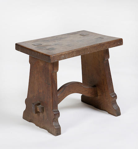 A joined oak stoolDesigned by Sir Robert Lorimer