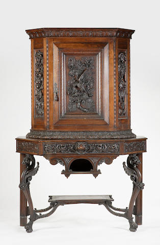 A carved oak cabinet on stand by Mary McEwen