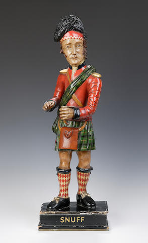 A late 19th century carved and polychrome painted Tobacconist's figure of a Scottish soldier