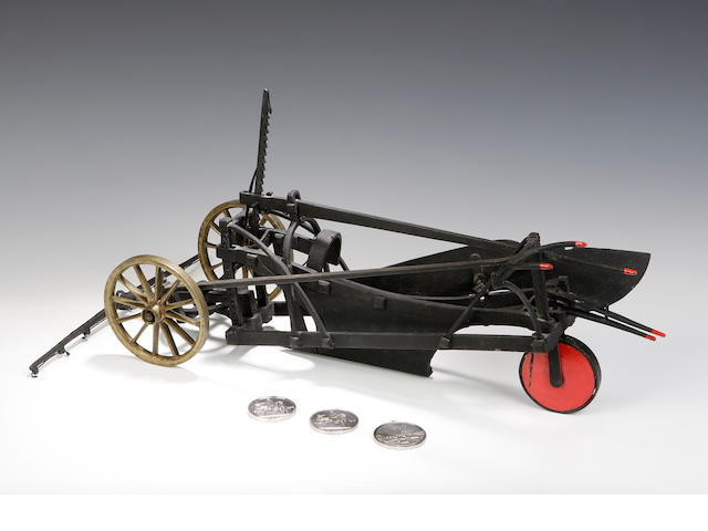 A mid 19thc iron model of a drain plough together with three silver prize medals