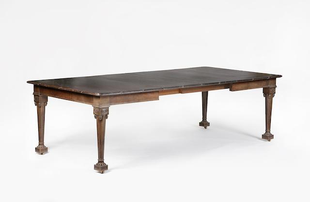 An early 20th century mahogany telescopic dining table
