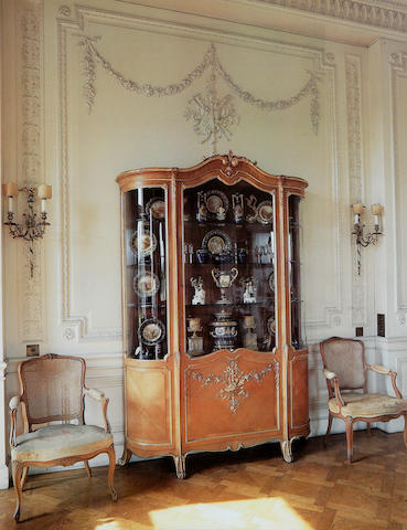 An early 20th century walnut and parcel gilt vitrine