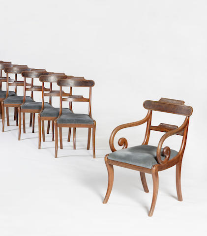 A set of twelve Regency mahogany and ebony strung dining chairs