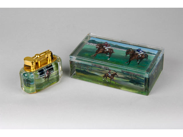 A Dunhill perspex and brass lighter and ensuite perspex cigarette box