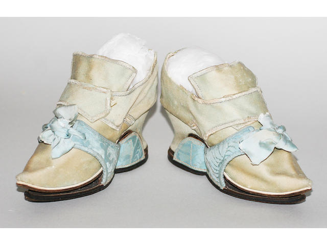 A pair of mint green shoes, together with a pair of ice blue damask patten, circa 1720