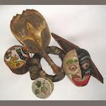 2 Mic-mac baskets, a birchbark canoe, a North American Indian turtle rattle, a Northwest coast 'totem', a Mexican polychrome mask, a South American drum and a Peruvian Shaman's horn