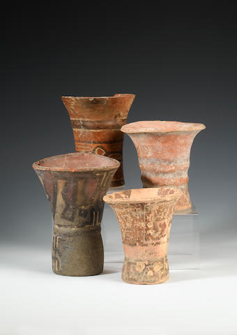 Six Tiahuanco pottery Keros and a goblet some damage to the vessels, 11cm.- 18cm., 7
