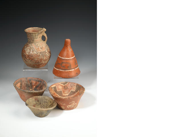 A group of Tiahuanco vessels of various shapes: ten bowls, one goblet and three jars