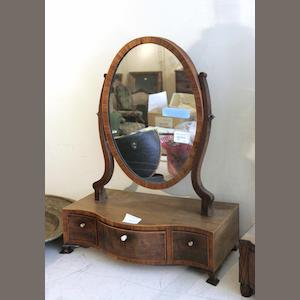 An early 19th century Edinburgh mahogany and boxwood strung dressing table, together with a Regency mahogany and inlaid serpentine dressing mirror