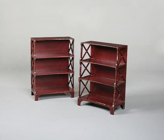 A pair of Regency style crimson painted four tier open bookcase