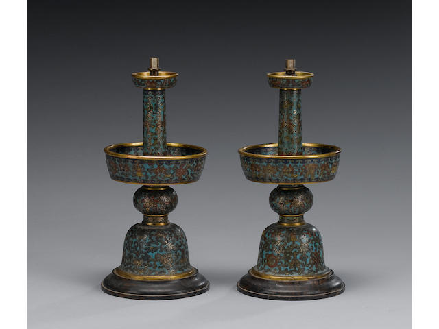 A pair of cloisonné enamel candlesticks of typical form