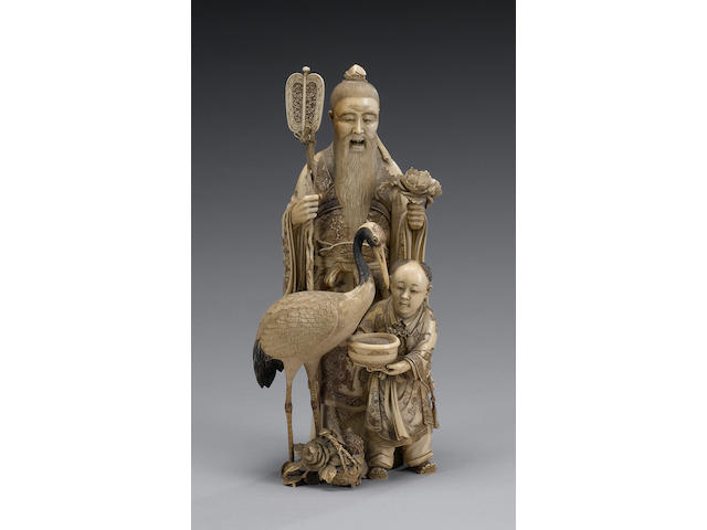 A stained ivory okimono of a Chinese Scholar,