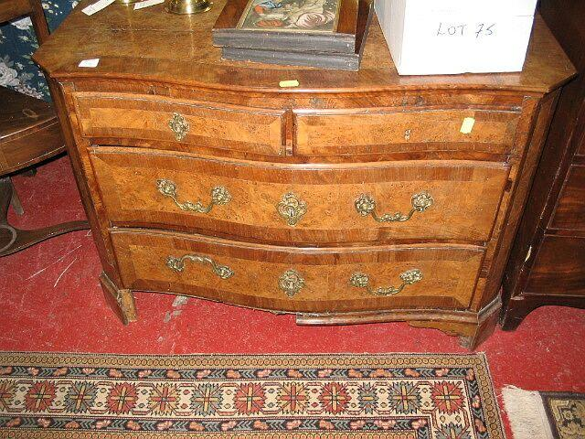 An 18th Century walnut and mahogany chest of drawers