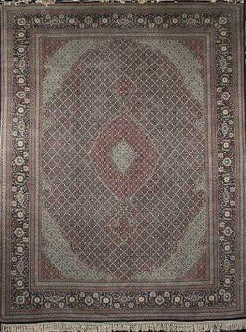 A Tabriz carpet North West Persia, 399cm x 284cm