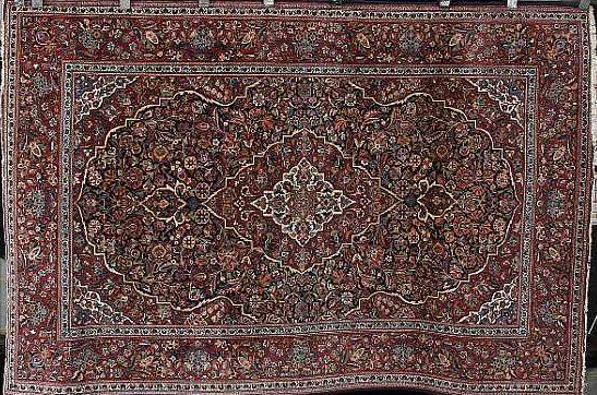 A pair of Kashan rugs Central Persia, 204cm x 138cm (2)