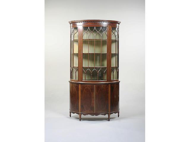 A good Edwardian mahogany and boxwood strung bow front display cabinet