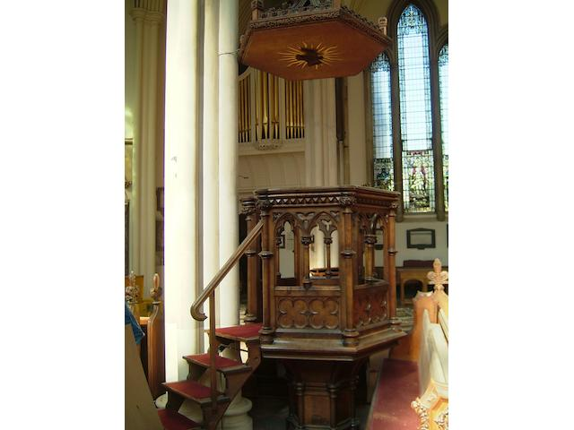 A carved oak pulpit of hexagonal shape