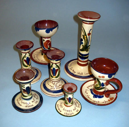 Seven Scandy ware candlesticks