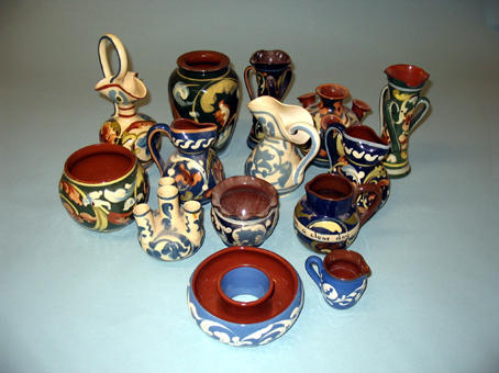 A group of Scroll ware on different coloured grounds
