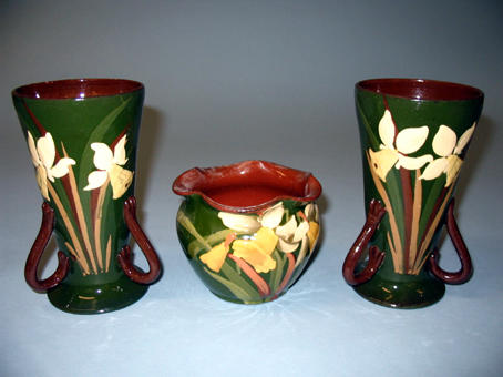 A pair of daffodil decorated vases