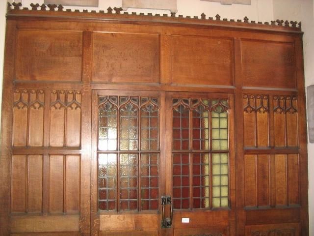 A pair of carved oak and glass panel doors