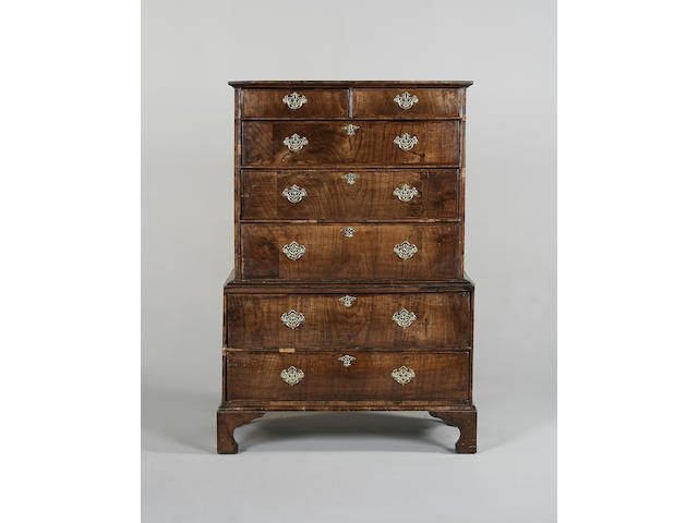 An early 18th century walnut and herringbone banded chest on chest