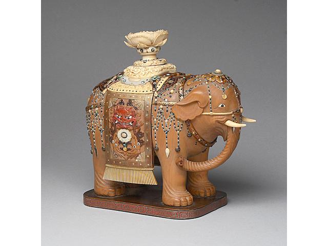 A Japanese carved boxwood, ivory and shibyama model of an elephant,
