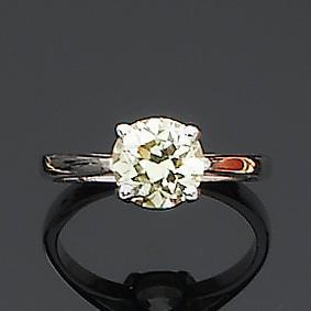 A fancy yellow diamond single-stone ring