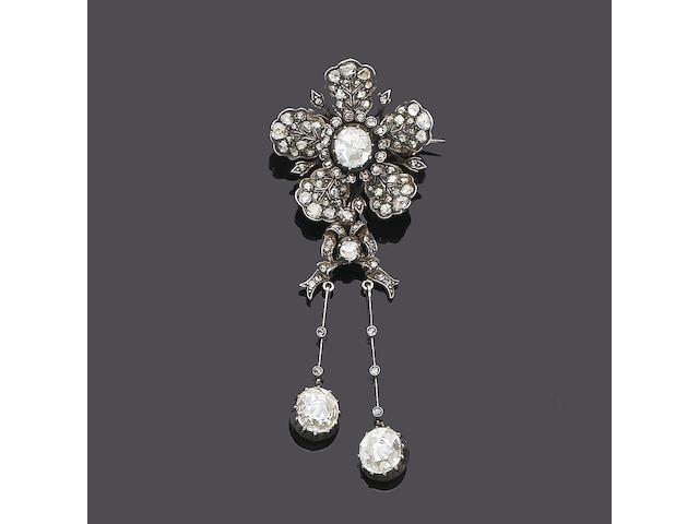 A late 19th century diamond flower brooch/pendant,