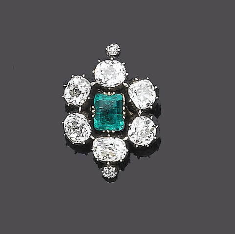 A 19th century emerald and diamond pendant/brooch