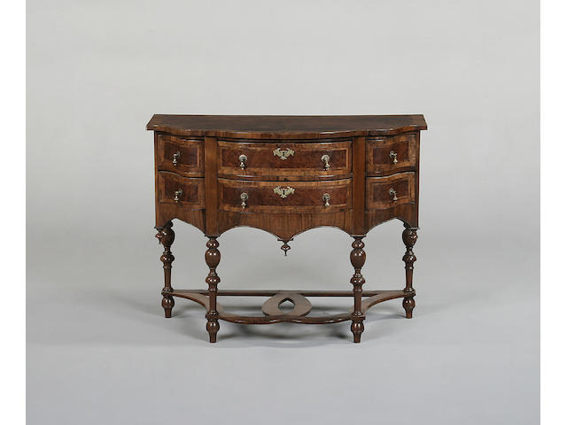 A William and Mary style walnut and crossbanded side cabinet
