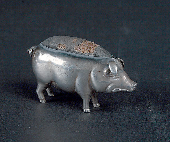 An Edwardian pincushion in the form of a pig,