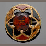 A gold mounted Scottish pebble brooch