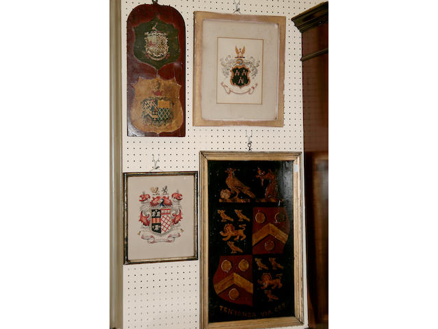 A wooden wall plaque inlaid with heraldic devices,