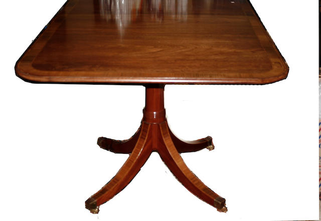 A reproduction crossbanded mahogany  Regency style twin pedestal dining table
