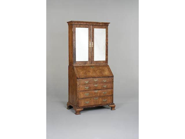 A George I walnut crossbanded and featherbanded bureau bookcase