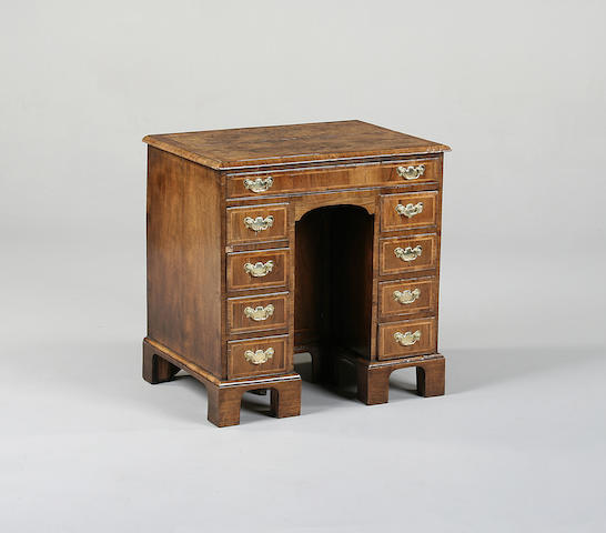 A mid 18th century burr walnut and walnut kneehole desk