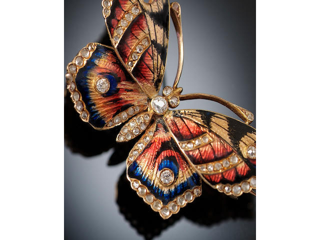 A diamond and enamel butterfly brooch