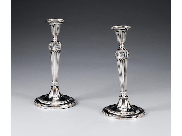 An early pair of George III Provincial silver candlesticks, by John Winter & Co, Sheffield 1779,